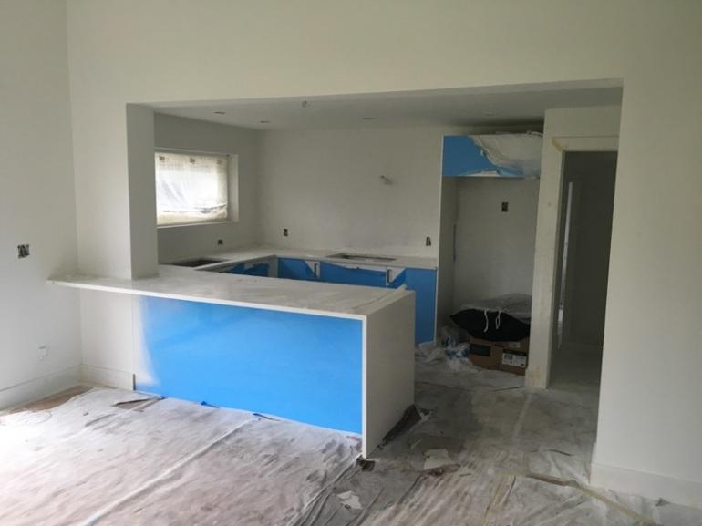 white-quartz-counter-install-modern-home-renovation